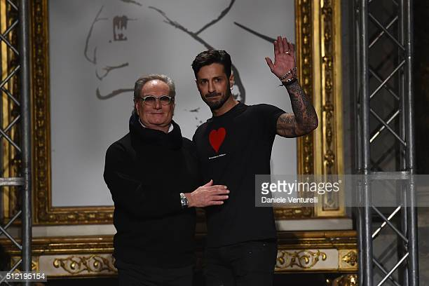 Designer Rocco Barocco and Fabrizio Corona acknowledges the applause of the audience after the Roccobarocco show during Milan Fashion Week...