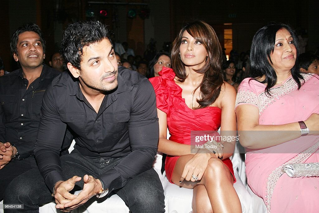 Designer Rocky S John Abraham Bipasha Basu and her mother at the launch of actress Bipasha Basu`s fitness DVD in Mumbai on February 4 2010
