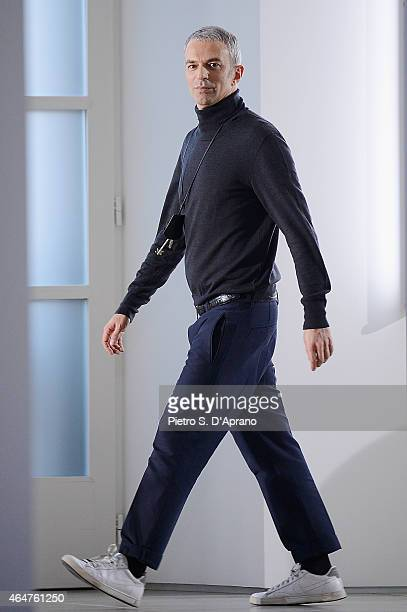 Designer Rodolfo Paglialunga acknowledges the applause of the audience after the Jil Sander show during the Milan Fashion Week Autumn/Winter 2015 on...