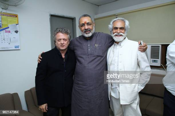 Designer Rohit Bal Union Minster of State for Micro Small and Medium Enterprises Giriraj Singh with Sunil Sethi president FDCI during the event Khadi...