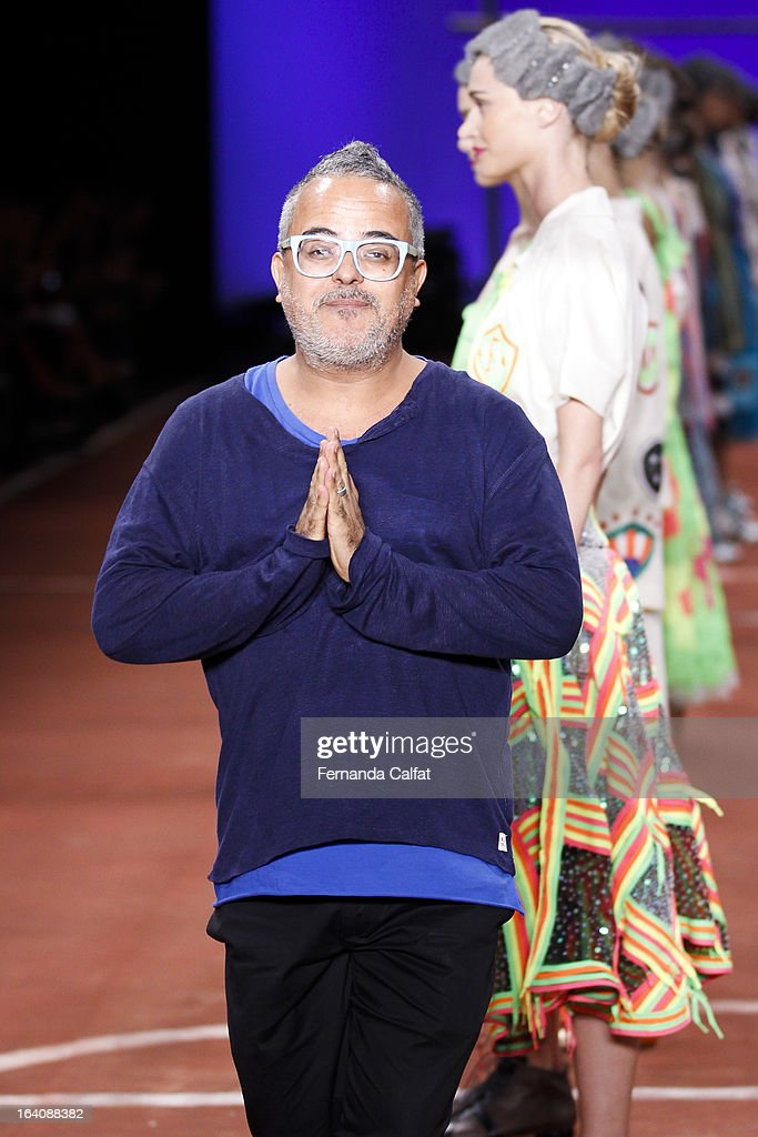 Designer Ronaldo Fraga walks the runway during the Ronaldo Fraga show as part of Sao Paulo Fashion Week Summer 2013/2014 on March 19, 2013 in Sao Paulo, Brazil.