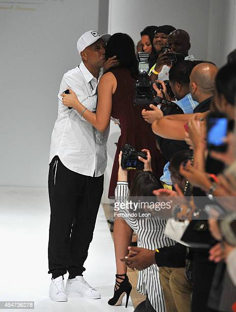 Designer Russell Simmons greets his former wife Kimora Lee during the Argyleculture By Russell Simmons fashion show at Helen Mills Event Space on...