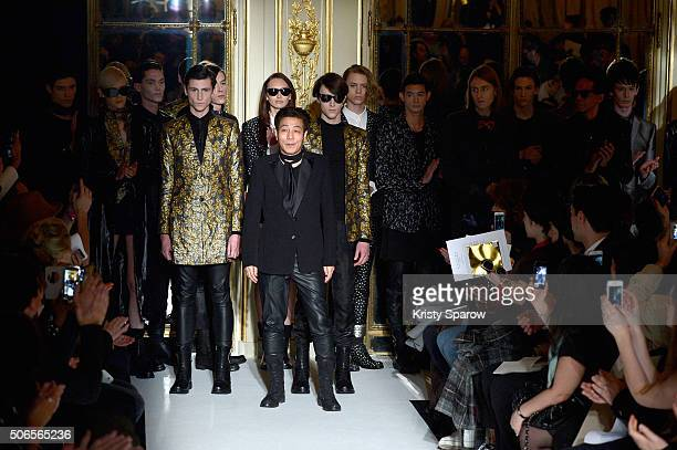 Designer Rynshu poses with models as he acknowledges the audience during the Rynshu Menswear Fall/Winter 20162017 show as part of Paris Fashion Week...
