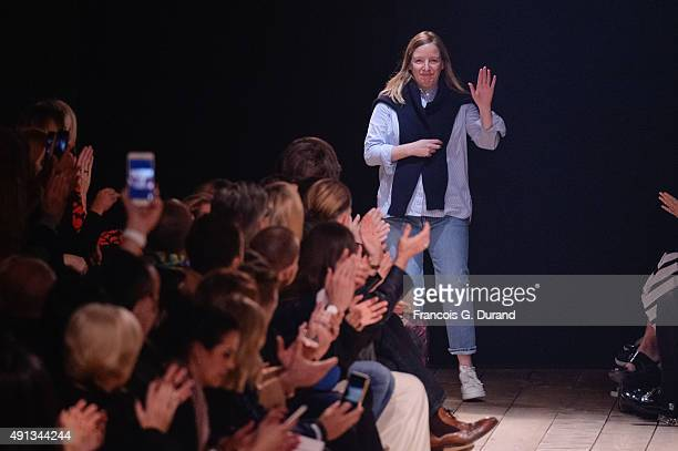 Designer Sarah Burton acknowledges the audience at the end of the Alexander McQueen show as part of the Paris Fashion Week Womenswear Spring/Summer...