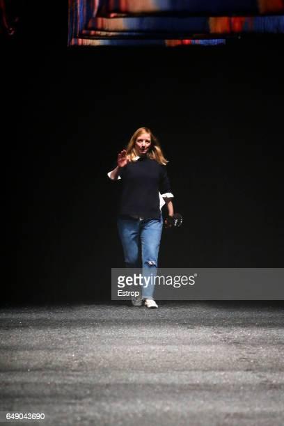 Designer Sarah Burton walks the runway during the Alexander McQueen designed by Sarah Burton show as part of the Paris Fashion Week Womenswear...