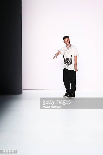 Designer Sasa Kovacevic on the runway after the Sadak show during the MercedesBenz Fashion Week Berlin Spring/Summer 2016 at Brandenburg Gate on July...
