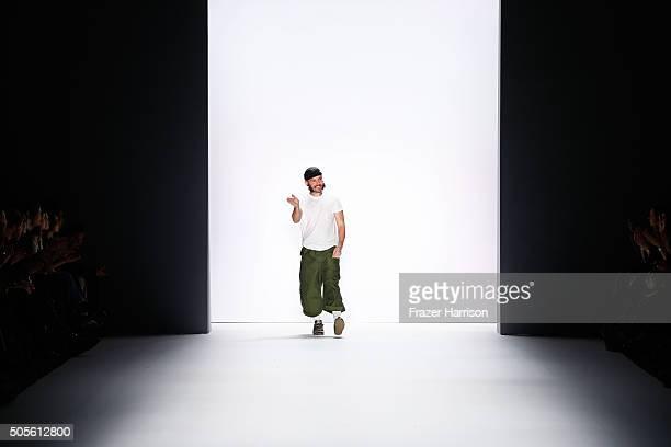 Designer Sasa Kovacevic waves after his label Sadak runway show during the MercedesBenz Fashion Week Berlin Autumn/Winter 2016 at Brandenburg Gate on...