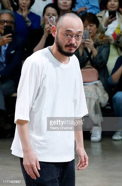 Designer Satoshi Kondo acknowledges the audience at the end of the Issey Miyake Womenswear Spring/Summer 2020 show as part of Paris Fashion Week on...