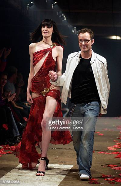 Designer Scott Henshall and a model on the catwalk at the Scott Henshall Fall 2003 Fashion show
