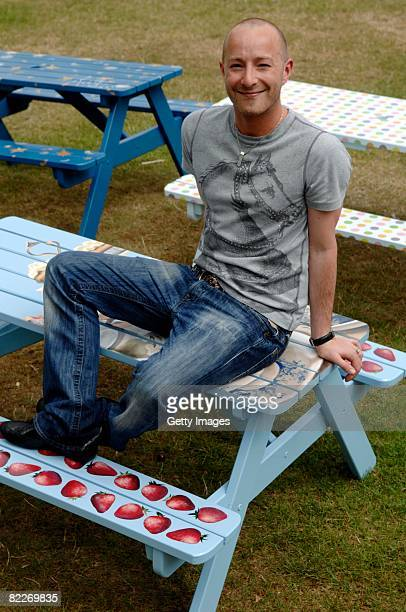 Designer Scott Henshall poses with the park bench he designed for the Children's Society launch of National Picnic Week on August 7 2008 in London...