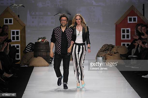 Designer Sean Hewson walks the runway at the Bustle fashion show during World Mastercard fashion week on March 20 2014 in Toronto Canada