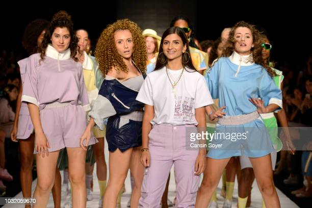 Designer Sebnem Gunay and models acknowledge the applause of the audience after the Karma II Third Sebnem Gunay show during the MercedesBenz Istanbul...