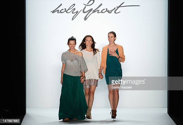 Designer Sedina Halilovic Ivana Bogicevic and Jelena Radovanovic acknowledges the audience the runway during the Holy Ghost Show at MercedesBenz...