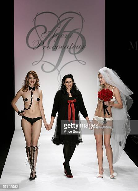 Designer Serena Rees and two models walk the runway at the Agent Provocateur Fall 2006 show during MercedesBenz Fashion Week at Smashbox Studios on...