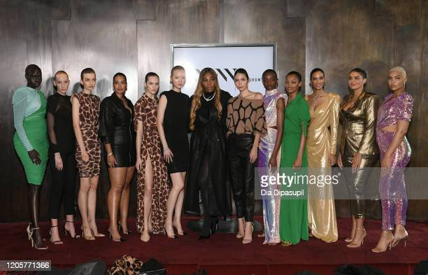 Designer Serena Williams poses with models for the S By Serena Presentation during New York Fashion Week The Shows at Spring Place on February 12...