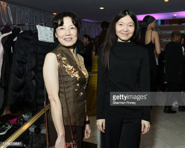 Designer Shafei Han joined by her mother backstage at the District of Fashion Fall/Winter 2019 Runway Show on February 07 2019 at the National Museum...