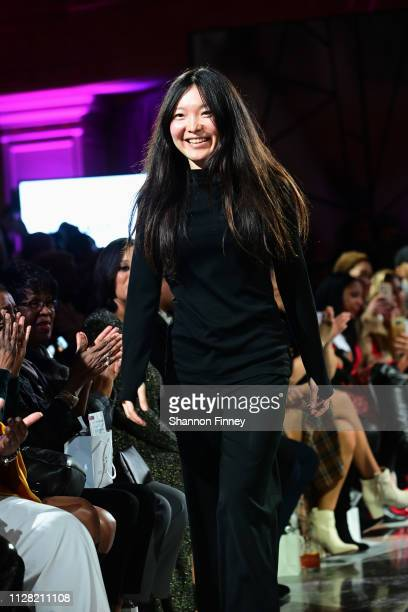 Designer Shafei Han takes a bow onstage at the District of Fashion Fall/Winter 2019 Runway Show on February 07 2019 at the National Museum of Women...