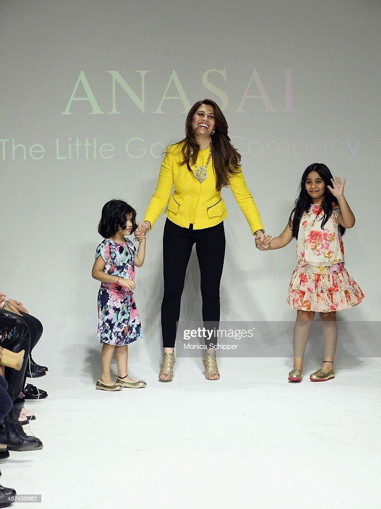 Designer Sharreen A. Talreja walks the runway during the Anasai preview at petitePARADE / Kids Fashion Week at Bathhouse Studios on October 18, 2014 in New York City.