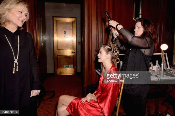 Designer Sherri Hill and a model prepare backstage at the Sherri Hill NYFW SS18 fashion show at Gotham Hall on September 12 2017 in New York City