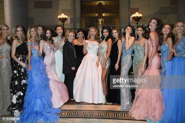 Designer Sherri Hill poses with her models backstage during the NYFW Sherri Hill Runway Show on February 9 2018 in New York City