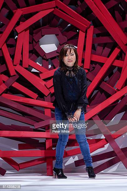Designer Shiatzy Chen acknowledges the applause of the public after the Shiatzy Chen show as part of the Paris Fashion Week Womenswear Fall/Winter...