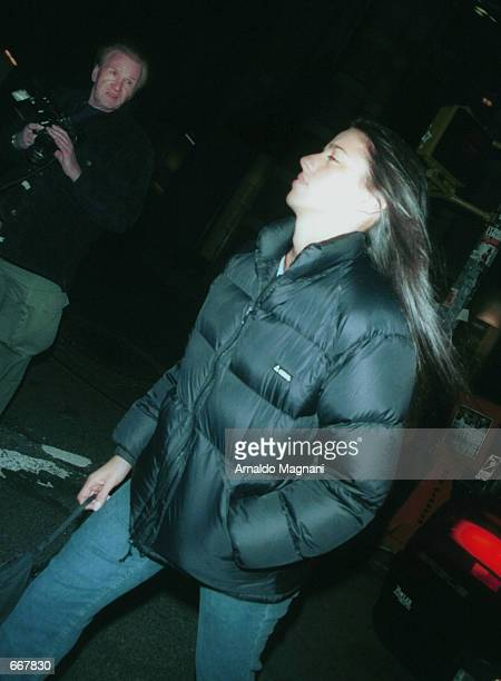 Designer Shoshanna Lonstein quickly walks away from photographers October 28 2000 after exiting Lucky Numbers at the Loew's movie theater with actor...