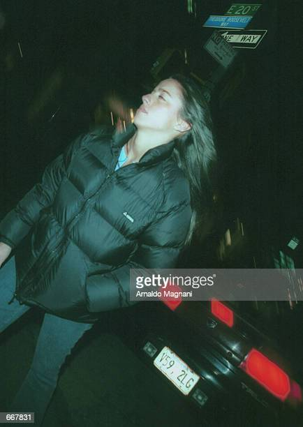 Designer Shoshanna Lonstein quickly walks away from photographers and actor Ben Affleck October 28 2000 after exiting Lucky Numbers at the Loew's...