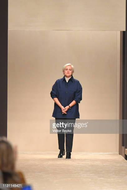 Designer Silvia Venturini Fendi acknowledges the applause of the audience after the Fendi show at Milan Fashion Week Autumn/Winter 2019/20 on...