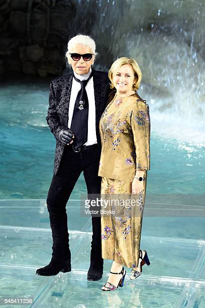 Designer Silvia Venturini Fendi and designer Karl Lagerfeld acknowledge the applause of the audience at the runway at Fendi Roma 90 Years Anniversary...