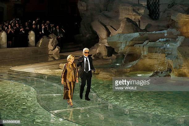 Designer Silvia Venturini Fendi and designer Karl Lagerfeld walk the runway at the Fendi Roma 90 Years Anniversary fashion show at the Fontana di...
