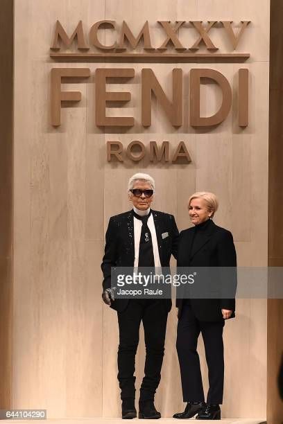 Designer Silvia Venturini Fendi and designer Karl Lagerfeld walk the runway at the Fendi show during Milan Fashion Week Fall/Winter 2017/18 on...