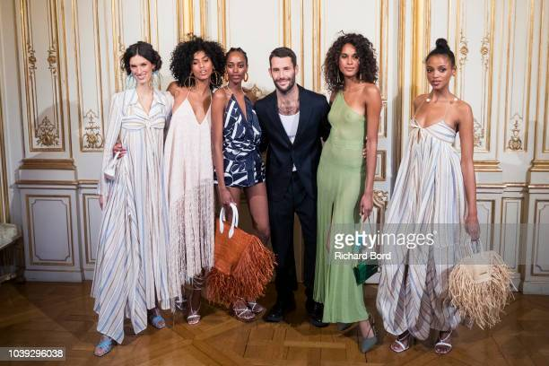 Image has been converted to black and white Designer Simon Porte Jacquemus and models pose on the runway during the Jacquemus show at the Italy...