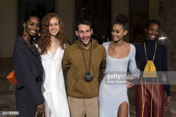 Designer Simon Porte Jacquemus poses with models backstage before the Jacquemus show as part of Paris Fashion Week Womenswear Fall/Winter 2018/2019...
