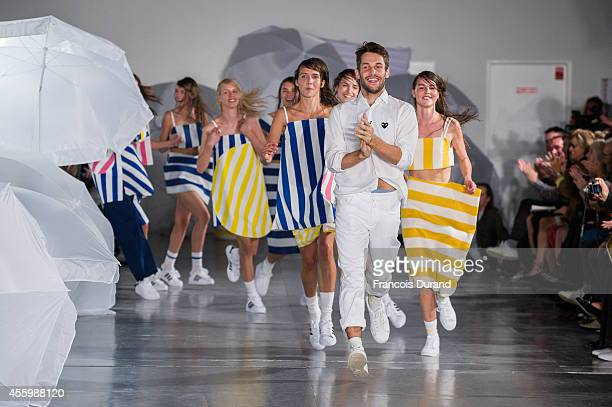 Designer Simon Porte Jacquemus walks the runway with models during the Jacquemus show as part of the Paris Fashion Week Womenswear Spring/Summer 2015...