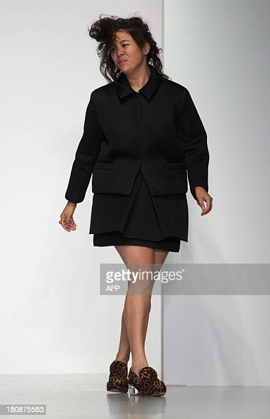 Designer Simone Rocha greets the audience at the end of her 2014 Spring/Summer catwalk show during the last day of the London Fashion Week in London...