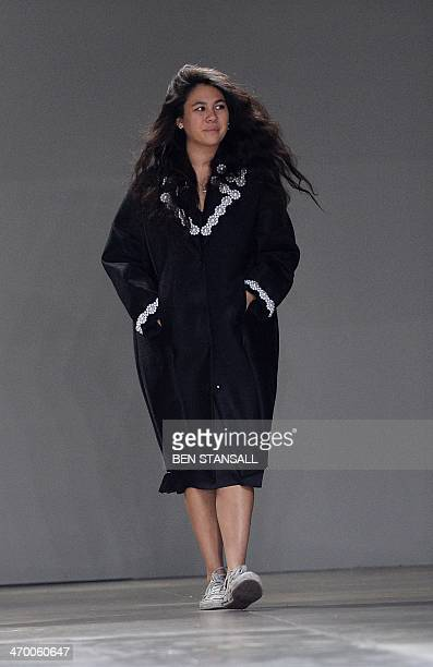 Designer Simone Rocha greets the crowd after her show at the 2014 Autumn / Winter London Fashion Week in London on February 18 2014 AFP PHOTO / BEN...