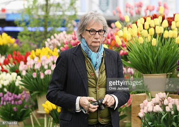 Designer Sir Paul Smith takes photographs during the Press and VIP preview day at Chelsea Flower Show at Royal Hospital Chelsea on May 18, 2009 in...