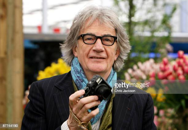 Designer Sir Paul Smith takes photographs during the Press and VIP preview day at Chelsea Flower Show at Royal Hospital Chelsea on May 18 2009 in...