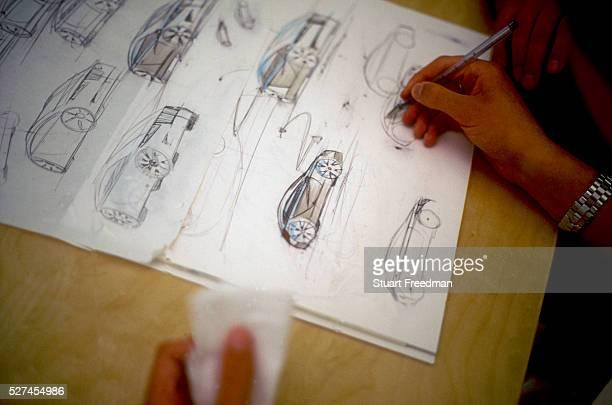 A designer sketeches plans for a new Jaguar sports car Jaguar design studios Coventry UK