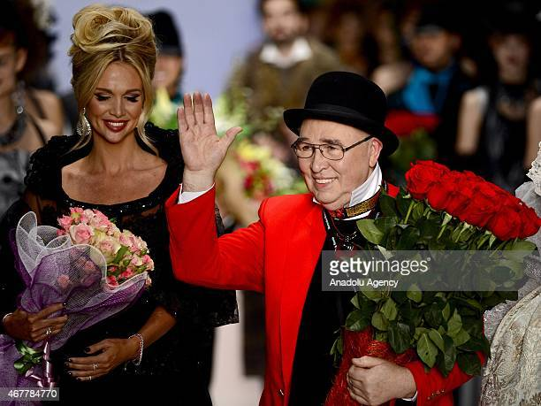 Designer Slava Zaitsev appears on the catwalk after the 2015/2016 Fall/Winter MercedesBenz Fashion Week Russia on March 27 2015 in Moscow