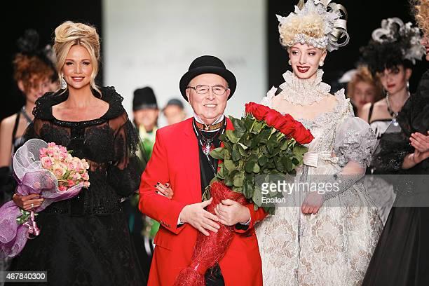 Designer Slava Zaitsev walks on the runway at the SLAVA ZAITSEV show during the MercedesBenz Fashion Week Russia Autumn/Winter 2015/16 at Manege on...
