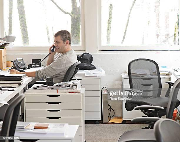 Designer smiles on telephone