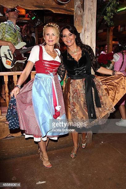 Designer Sonja Kiefer and Gitta Saxx attend the 'Almauftrieb' at Kaefer tent during Oktoberfest at Theresienwiese on September 21, 2014 in Munich,...