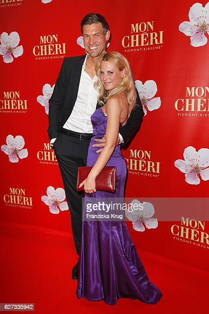 Designer Sonja Kiefer and her boyfriend Cedric Schwarz attend the Mon Cheri Barbara Tag at Postpalast on December 2 2016 in Munich Germany