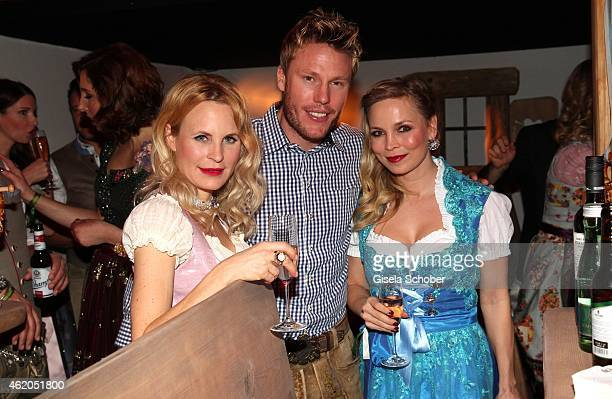 Designer Sonja Kiefer Christian Lell Regina Halmich during the Weisswurstparty at Hotel Stanglwirt on January 23 2015 in Going Austria