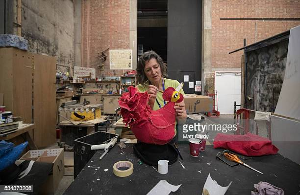 Designer Sophia Clist paints a prop backstage that she has made for The Flying Lovers of Vitebsk which is part of the Bristol Old Vic's 250th...