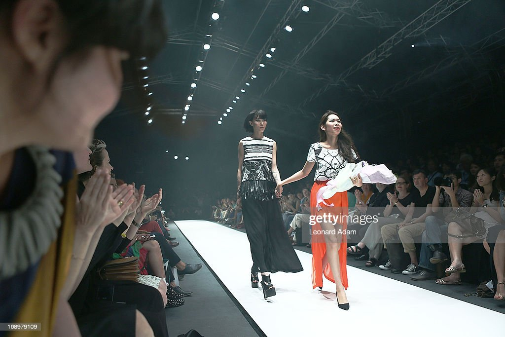 Designer Soravit Kaewkamon of Thailand walks the runway during the Audi Star Creation Capsule Showcase on May 17, 2013 in Singapore.