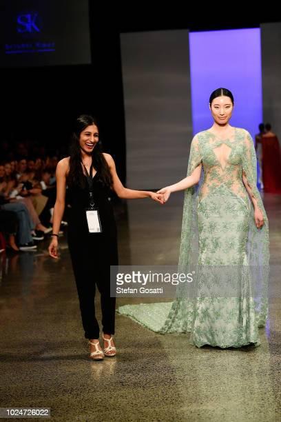 Designer Srishti Kaur thanks the audience following the Srishti Kaur Designs runway during the New Generation Emerging Couture show during New...