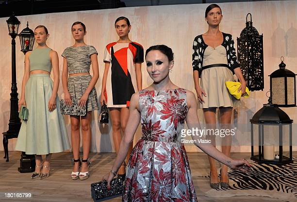 Designer Stacey Bendet poses with models at the alice + olivia by Stacey Bendet presentation during Mercedes-Benz Fashion Week Spring 2014 on...