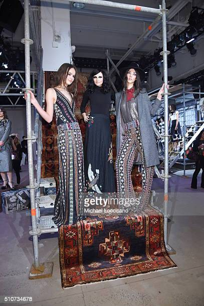 Designer Stacey Bendet poses with models at the alice olivia by Stacey Bendet Fall 2016 presentation at The Gallery Skylight at Clarkson Sq on...